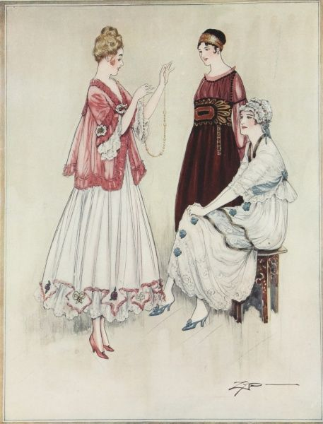 Three elegant ladies modelling tea dresses and boudoir gowns from the World War I period