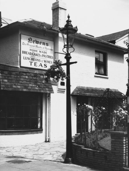 The 'Original Maids of Honour' tea shop at Kew in Surrey. An old gas lamp stands outside the building