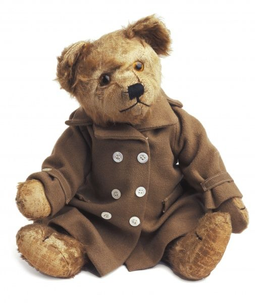 An amiable looking teddy bear with obligatory threadbare paws and smart brown coat