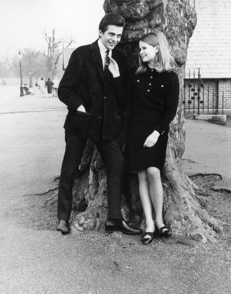 A teenage couple in the park. Date: mid 1960s