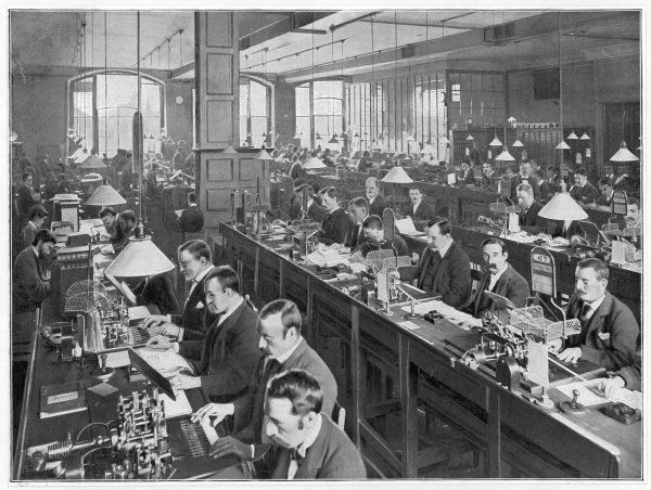 Around a hundred telegraph clerks are employed in this one room alone at the Central Telegraph Office, London