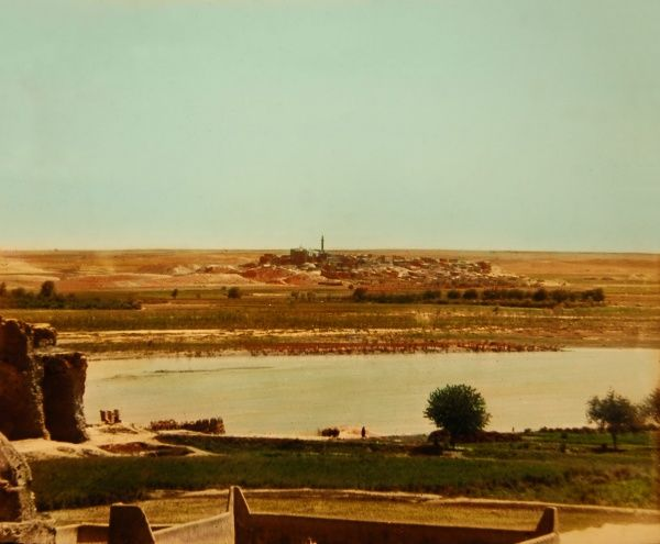 The site of Nineveh on the Eastern bank of the River Tigris in Iraq - viewed here from Mosul, across the River. Nineveh's location is marked by two large mounds, Kouyunjik and Nebi Yunus ('Prophet Jonah'), and the remains of the city walls