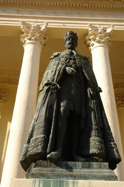 The statue of King George V in front of the Temple of Fame at Barrackpore, near Kolkata (Calcutta), India. The Temple was built in the early 19th century in memory of 24 British officers who died in action. The statue is a later addition