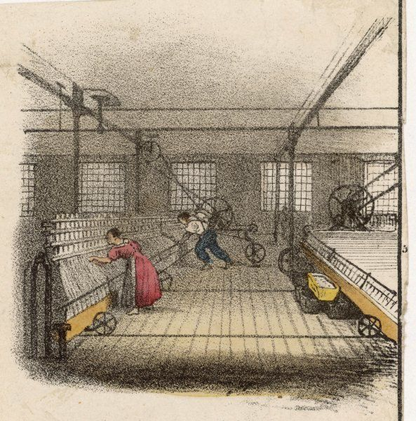 Interior of cotton mill with man and woman bending over spinning machines