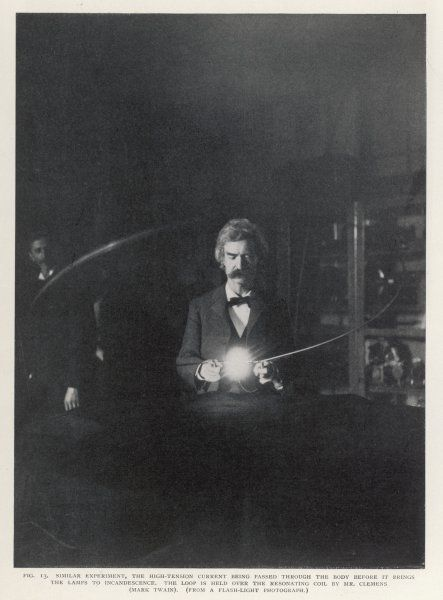 TESLA'S COIL Author Mark Twain holds a loop over a resonating coil : high- tension current passes through his body before it brings the lamps to incandescence