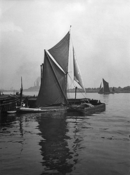 Sailing barges on the River Thames at Galleons Reach, the stretch of river between Woolwich and Barking and the entrance to the docks. Date: 1930s