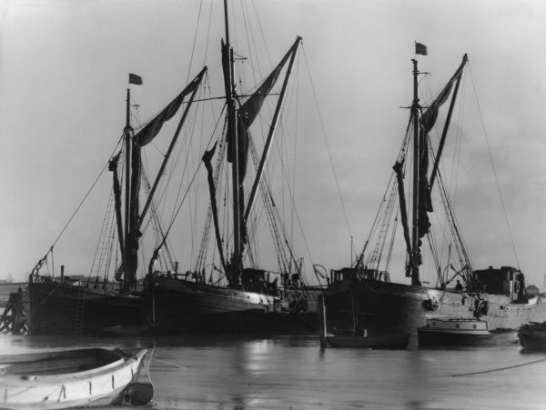 One the Hard, Brightlingsea, Essex, England. Here are laid up for repairs two 'Stumpy's' Thames barges and one 'Top Sail' coasting barge. Date: 1950s