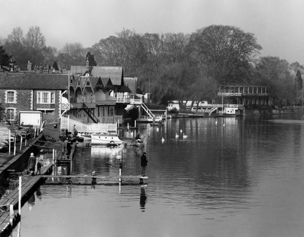 Rowing boathouses on the River Thames, England. Date: 1960s