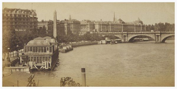 The river at Charing Cross, with the Embankment and Cleopatra's Needle to the left, the 'Cleopatra' swimming bath in the foreground