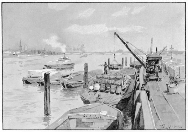 The river bank at NINE ELMS, South Lambeth : barges are being loaded from a steam crane at Nine Elms pier