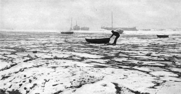 A scene during the great freeze of 1947, one of the harshest winters known in Britain. At Leigh-on-Sea in Essex, a boatman is pictured rescuing his dinghy from the encircling ice which makes the Thames Estuary look more like a Polar landscape