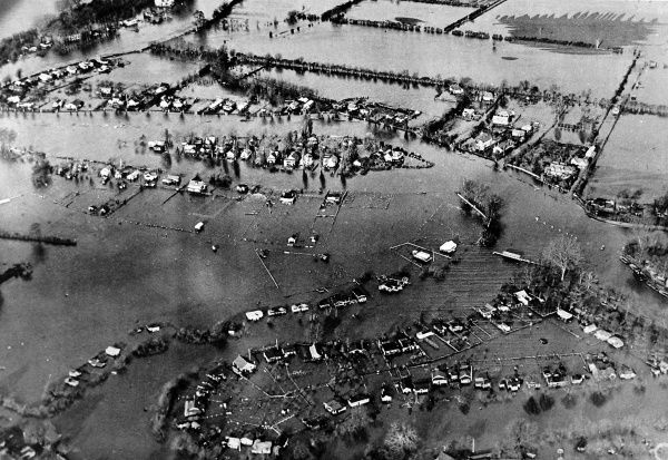 The flooded area about Weybridge, after unprecedented rainfall the Thames burst its banks. The course of the river untraceable where the banks of the river have merged into the land