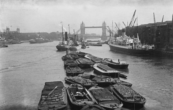 Barges on the Thames, seen from London Bridge, looking towards Tower Bridge