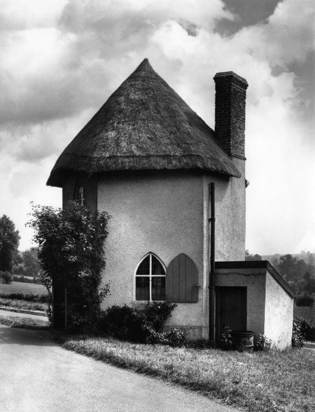 The six-sided Toll House at Llanfair Gate, Isle of Anglesey, Wales. Date: 1950s