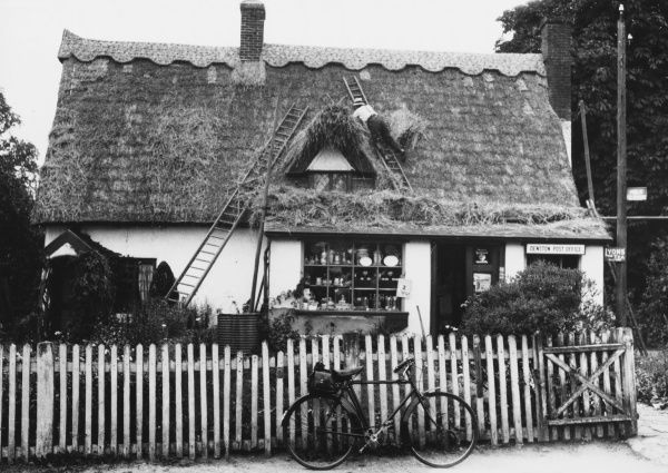 Thatching the village post office at Denton, Suffolk, England
