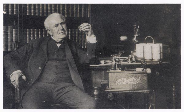 THOMAS ALVA EDISON American inventor with his Edison Business Phonograph