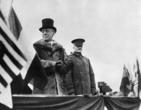 Thomas Woodrow Wilson (1856-1924), American President, with General John Pershing (1860-1948), American army officer. Seen here at a celebration in France not long after the First World War had ended. Date: 16 December 1918