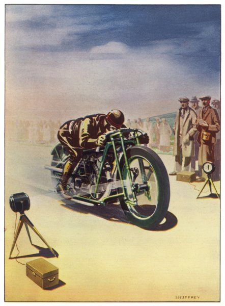 Timing a motor cycle : when the machine crosses beams from photo-electric cella at the start and finish of the run, the time is measured. (In fact, the beam is invisible.)