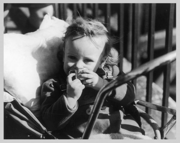 A Working Class child in a pushchair