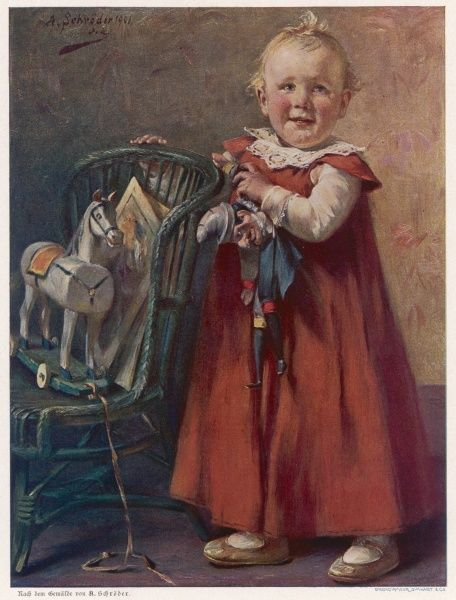 A happy child plays with a toy horse on wheels and a Mr Punch puppet