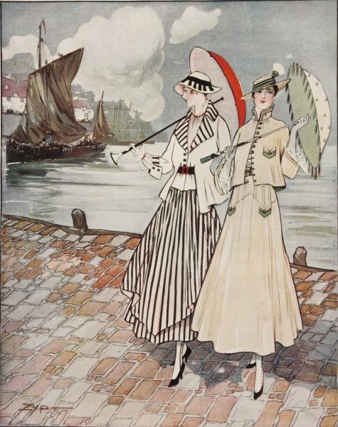 Two elegant women wearing the latest fashions from 1915, pose at a harbour side holding parasols
