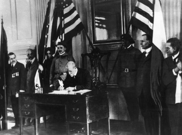 Tomas Garrigue Masaryk (1850-1937), Austro-Hungarian and Czechoslovak politician, founder and first President of Czechoslovakia. Seen here in Philadelphia, USA, signing the Declaration of Freedom and Cooperation of the Mid-European Nations. Date