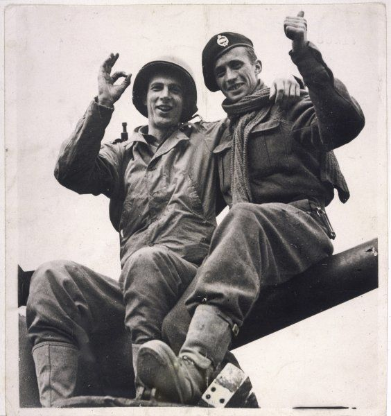 Tommy and Yank, British and American brothers in arms, celebrate the Allied victory in Germany