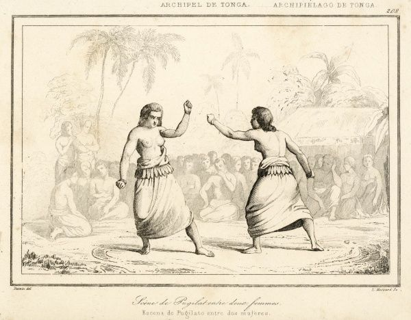 Two bare-breasted Tongan women fight it out as a predominantly male crowd enjoys the fun
