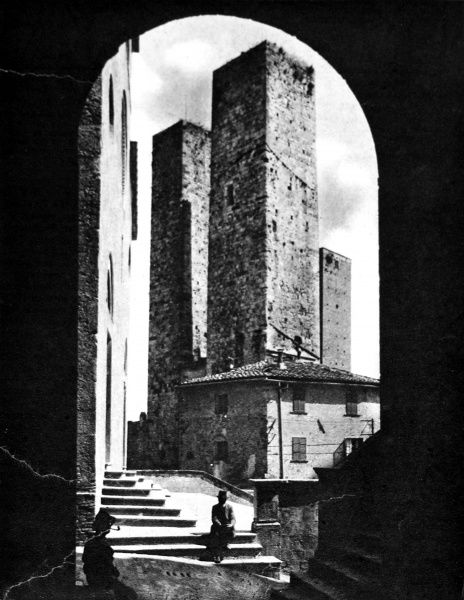 Photograph showing the Torri degli Ardinghelli, or Towers of the Guelphs, at the eleventh-century hill-top town of San Gimignano, near Siena, Italy, prior to July 1944