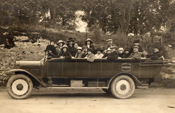 A Tour party to the grotto of our Lady at Lourdes in a large Charabanc
