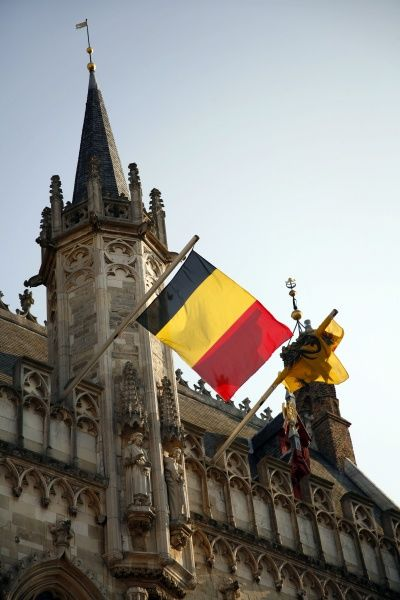 Bruges Town Hall and Belgian flag in Burg Square, Bruges, Belgium circa 2008