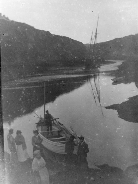 A view of trading vessels, with a group of people on the shore, at Solva, Pembrokeshire, Dyfed, South Wales