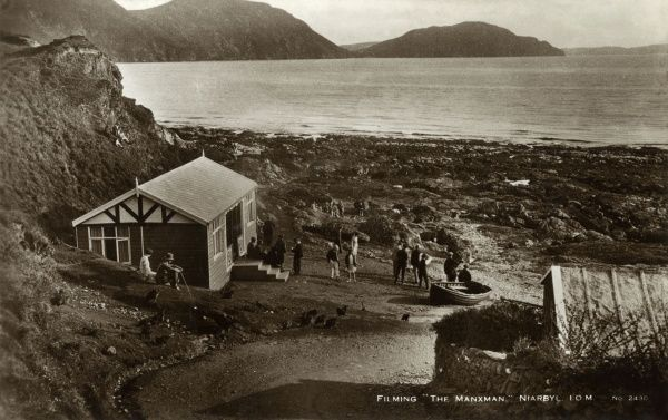 View of a traditional cottage at Niarbyl, on the south west coast of the Isle of Man, with a film crew working on The Manxman (1929, directed by Alfred Hitchcock, based on a novel by Hall Caine). Date: late 1920s
