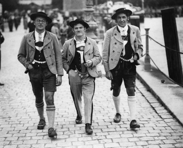 Three German (possibly Bavarian) men in traditional costume, two of them in lederhosen. Date: 1930s