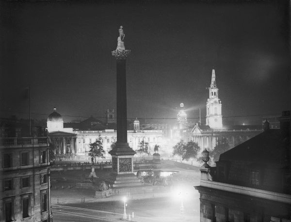 Trafalgar Square and Nelson's Column, floodlit at night, one month before the outbreak of World War Two. Date: August 1939