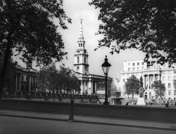 Looking across Trafalgar Square towards St. Martins-in- the-Fields church, London. Date: 1930s
