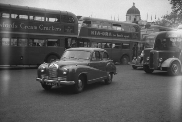 Traffic around Trafalgar Square, London - Austin A40 Somerset in foreground. Photograph taken on the day of the 1953 Derby at Epsom
