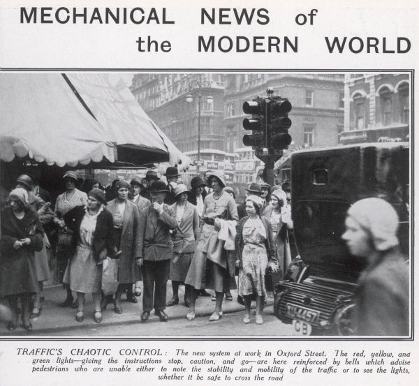 The new traffic light system in operation in Oxford Street, London in 1931 with uncertain pedestrians still warily looking for oncoming traffic