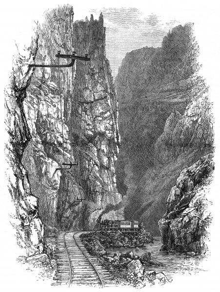 A train passes through the Grand Canyon of Arkansas. Date: 1887
