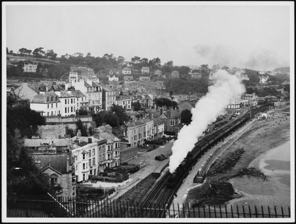 A steam train passing through the picturesque town of Dawlish in Devon, England