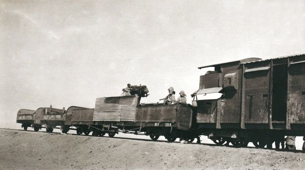 Soldiers preparing to fire a train-mounted artillery piece, somewhere in Iraq