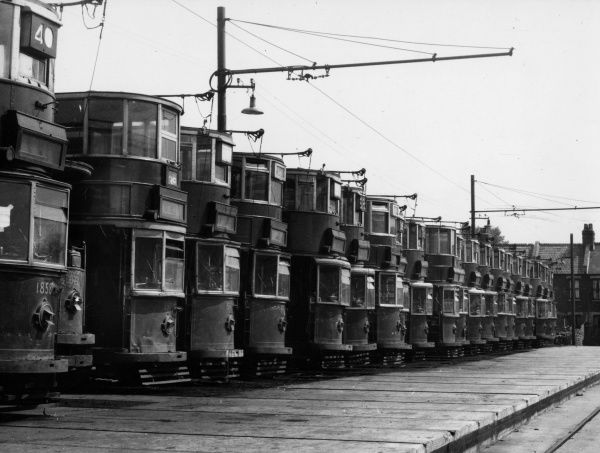 The sad sight of a row of London Transport trams in their 'graveyard' (having been replaced by buses), Charlton, south east London. Date: 1950s
