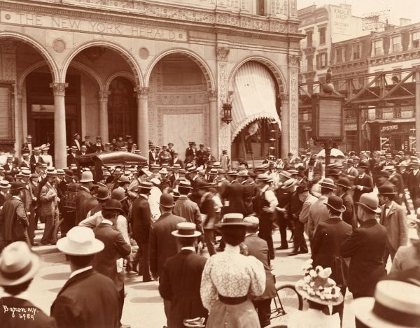 Woman on End of Transcontinental Auto Tour, 1899. Crowd gathered in front of the New York Herald building, Herald Square, at the finish of a woman's transcontinental auto tour
