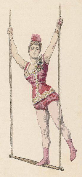 The trapeze artist standing on her trapeze