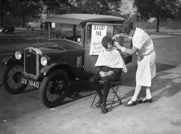 'Roadside Beauty Service'. A travelling hairdresser gives a girl a fashionable haircut