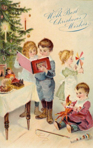 Four children sit and stand by the tree, admiring their presents