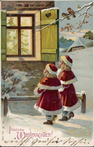 Two girls in Santa costume stand outside the house, looking through the window at the tree inside