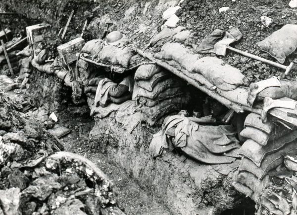 A trench scene during the First World War, with soldiers asleep in their dugouts