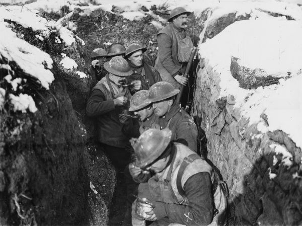 Soldiers of the 6th Queen's (Royal West Surrey) Regiment eating dinner in the trenches at the Battle of Arras on the Western Front in France during World War I in March 1917