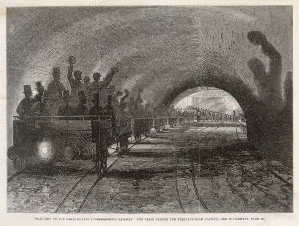 A successful trial trip on the Metropolitan Railway : the train - drawn by a steam locomotive - is about to enter Portland Road station, near Euston